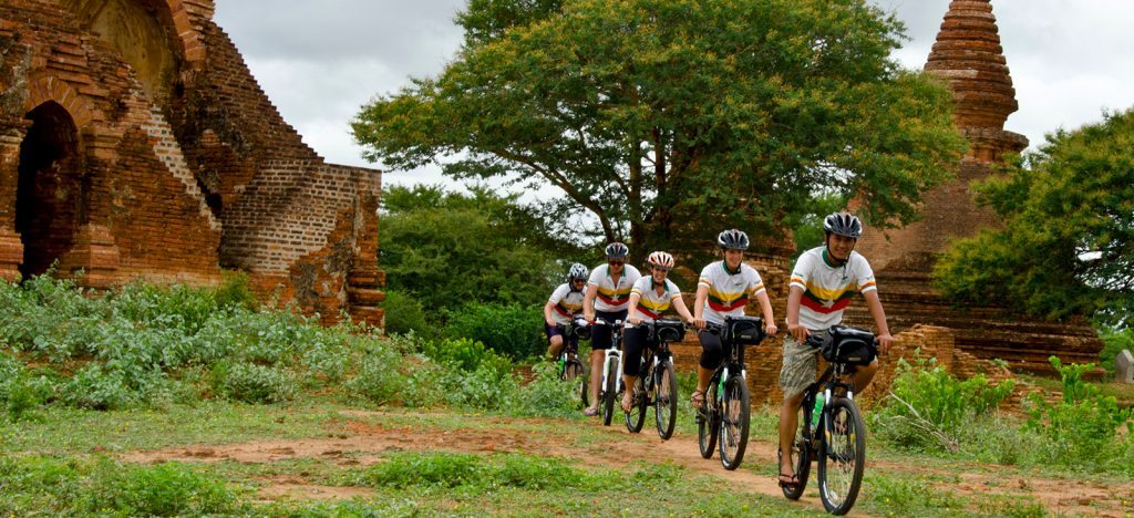 Five cyclists riding through the temples of Bagan