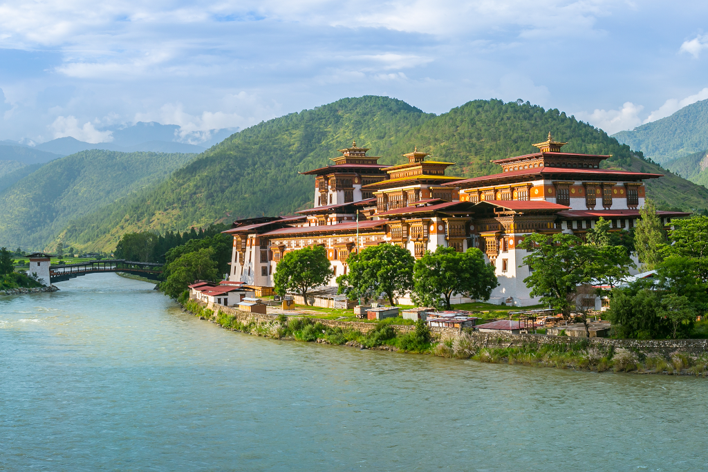 Punakha Dzong on river with hills in the background