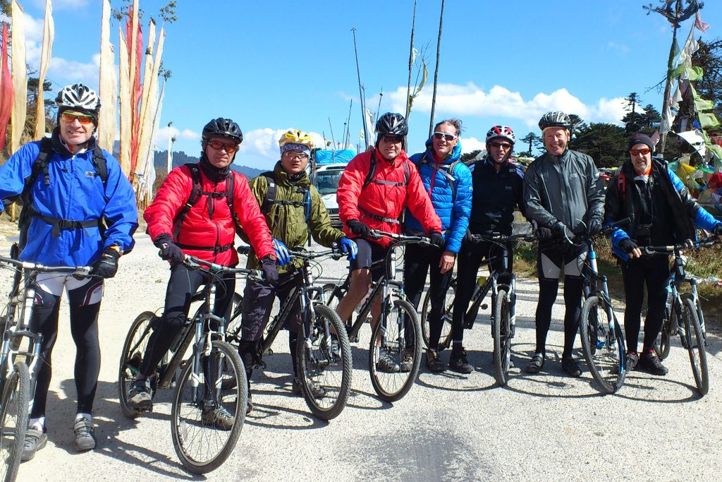 Eight cyclists in helmets with bikes