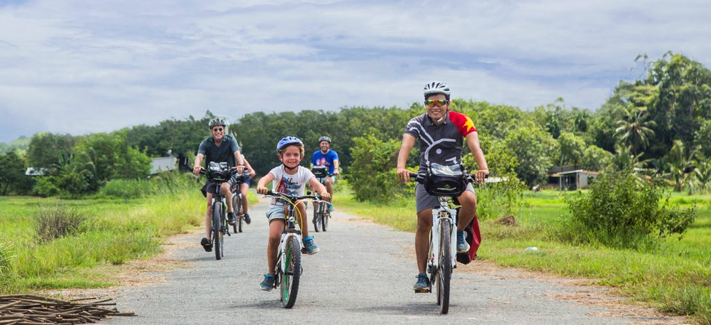 Family and guide cycling in Vietnam