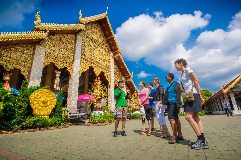 Guide talking to five travelers outisde of Wat Phra That Doi Suthep in Chiang Mai Thailand