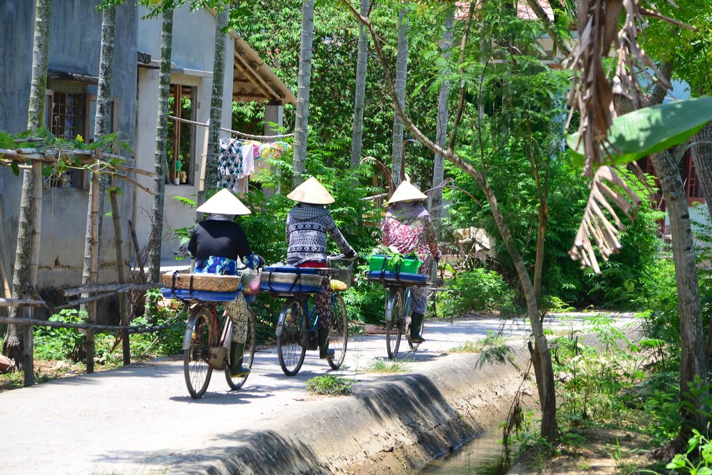 Vietnamese women cycling home from the market