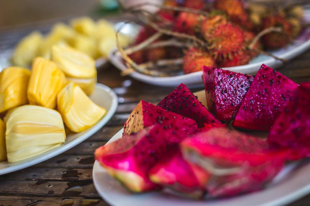 Plates of dragonfruit, jackfruit, and lychee