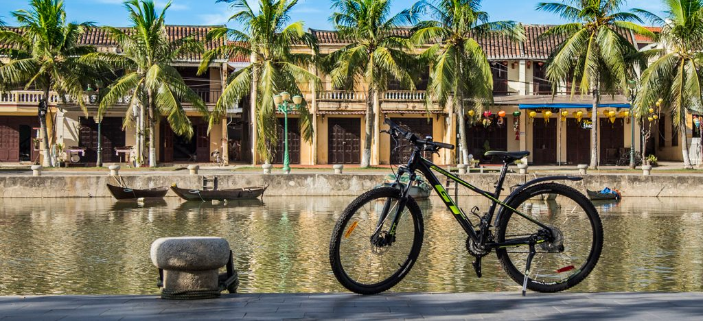 GT Avalanche Sport bike parked in front of river in Vietnam