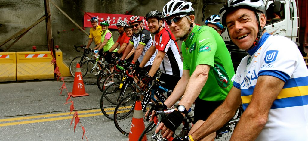 Cyclists in helmets at starting line