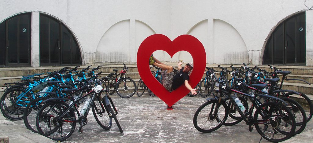 Simon in heart surrounded by bikes