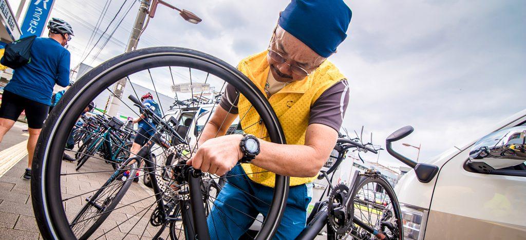 Mechanic fixing bike tire