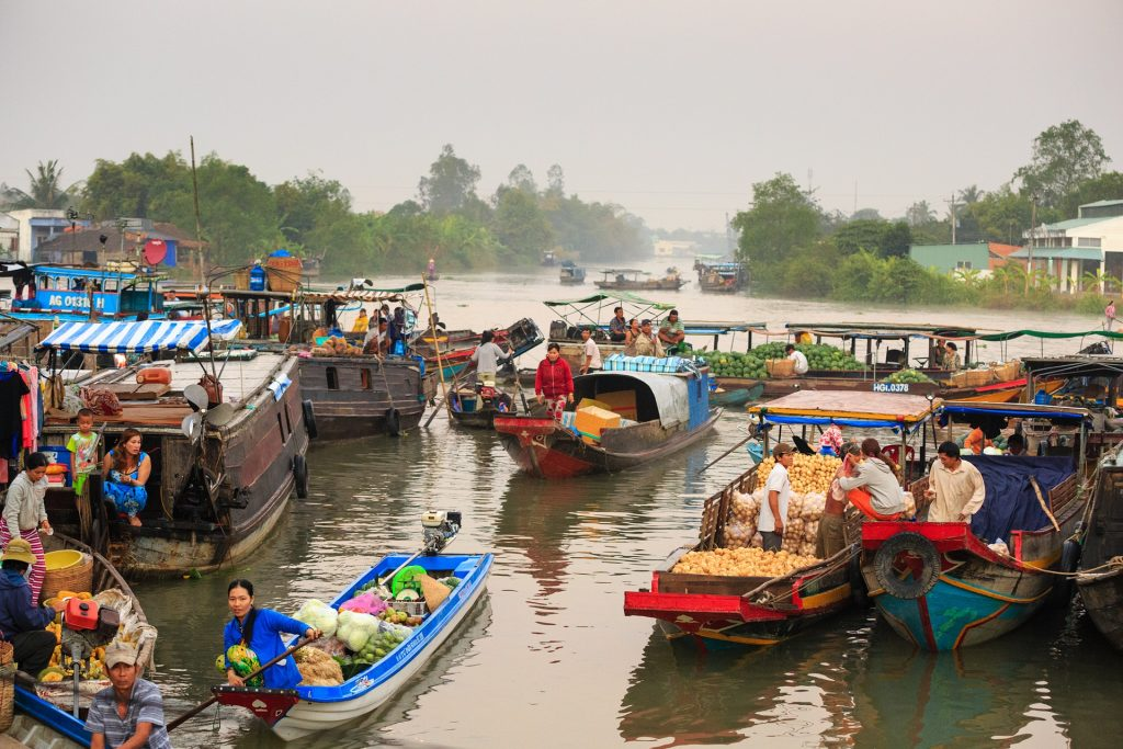 Locals on boats with their products to sell at market