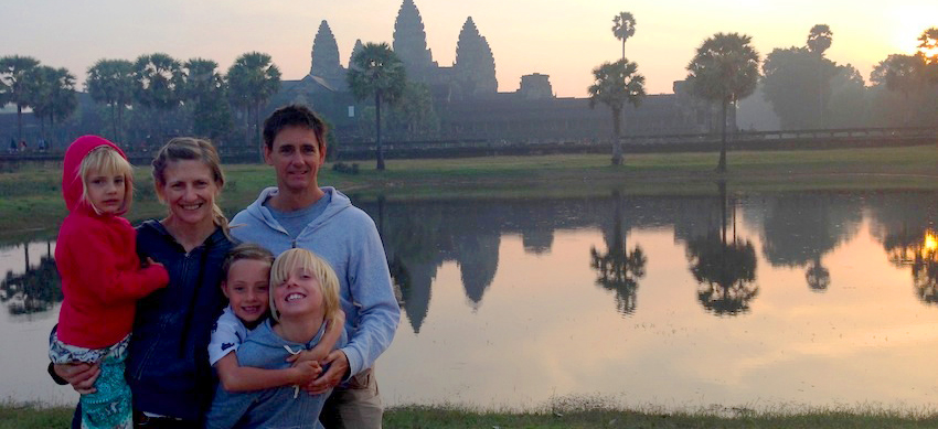 Family with three children in front of Angkor Wat at sunrise