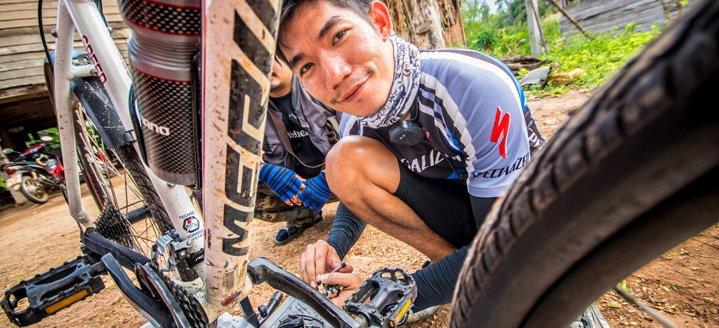 Mechanic fixing bike