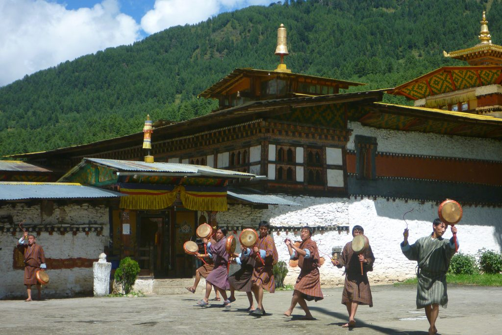 Locals playing drums in front of Dzong in Bhutan