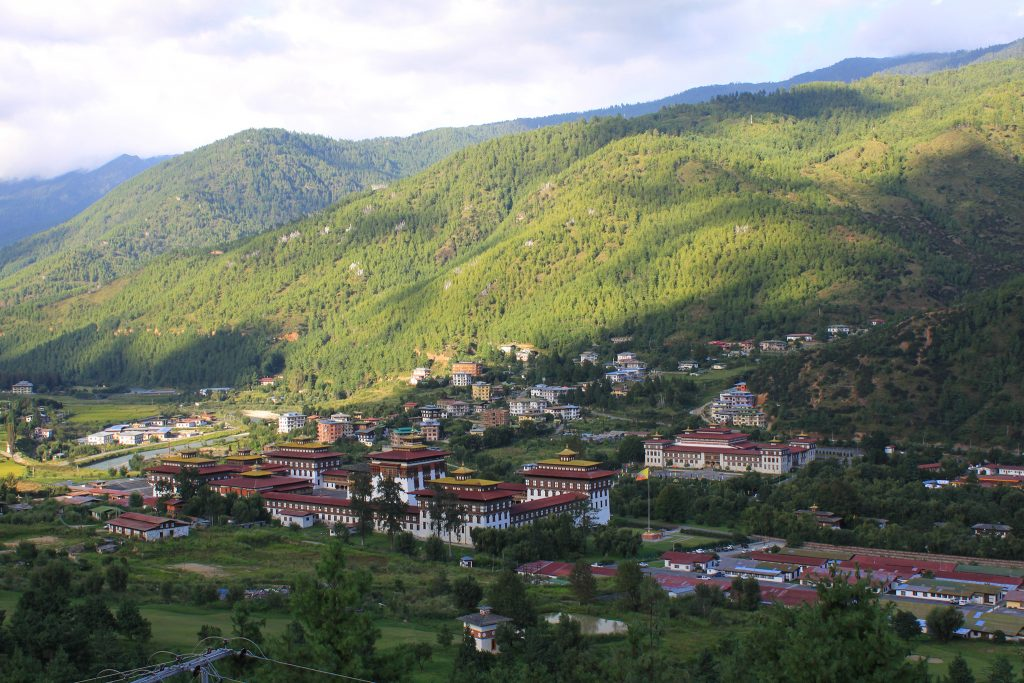 Buildings of Bhutan with hills in background