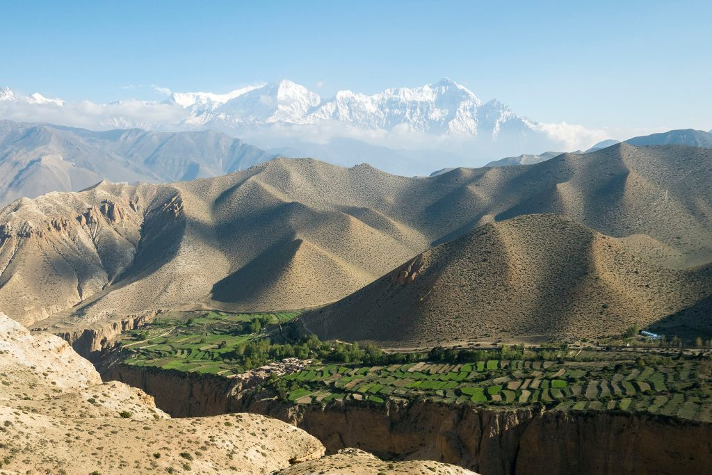Sandy mountains and green valley in Upper Mustang of Nepal