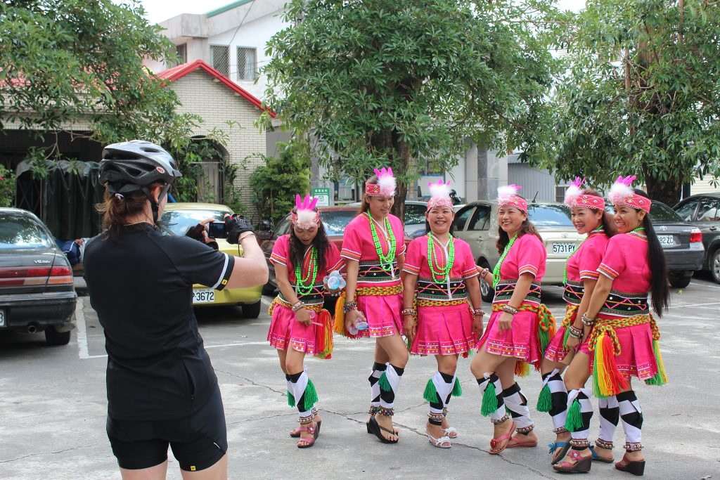 Cyclist photographing traditional costume in Taiwan