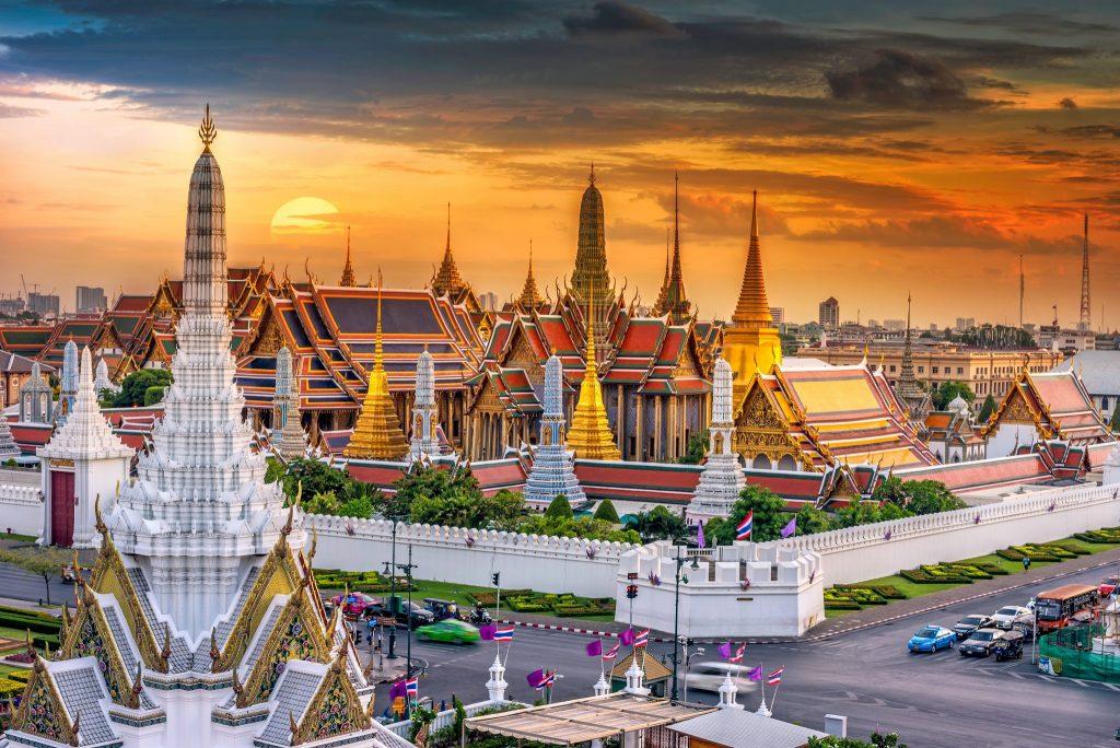 Spires of the Grand Palace in Bangkok at sunset